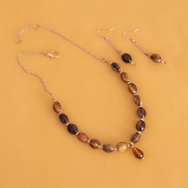 Collar y aretes de semillas doradas y pendiente Swarovski